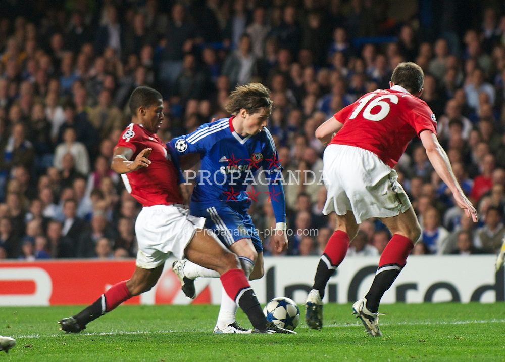 LONDON, ENGLAND, Wednesday, April 6, 2011: Chelsea's Fernando Torres is fouled by Manchester United's Antonio Valencia during the UEFA Champions League Quarter-Final 1st leg match at Stamford Bridge. (Photo by David Rawcliffe/Propaganda)