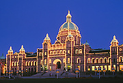 Parliament Building with lights on at dusk; Victoria, Vancouver Island, British Columbia, Canada.