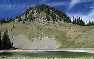 We were hiking outside of Jackson, WY, when we came across this pond. I liked the way the wispy clouds accentuated the shape of the mountain.