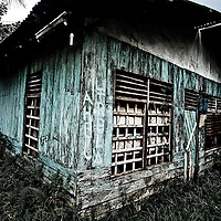 Where: Papua, Indonesia. I love the weathered look of the old house.