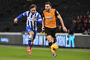 Hull City midfielder Robert Snodgrass (10) ,Brighton defender, full back, Inigo Calderon (14)  during the Sky Bet Championship match between Hull City and Brighton and Hove Albion at the KC Stadium, Kingston upon Hull, England on 16 February 2016. Photo by Ian Lyall.