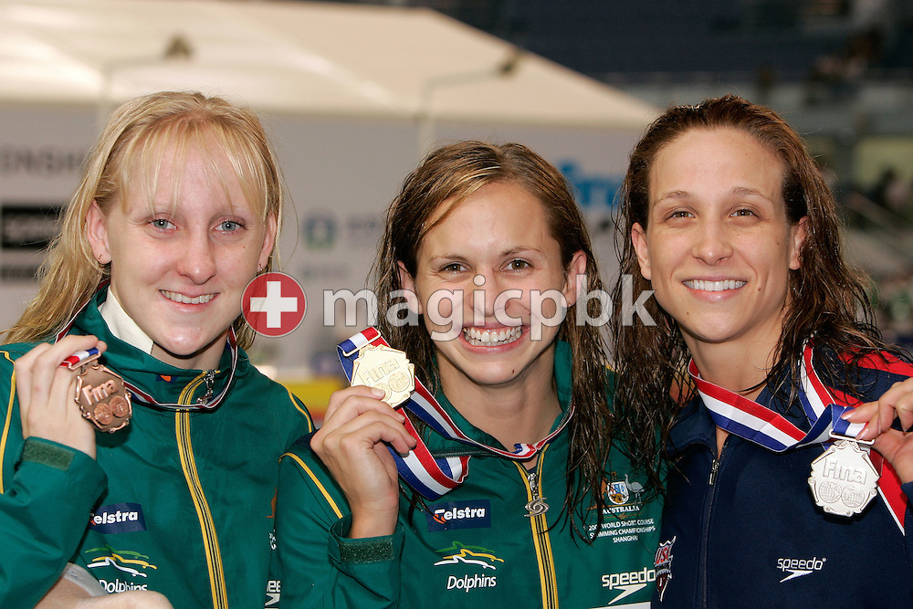 (L-R) Jessicah SCHIPPER of Australia wins the bronze medal, Lisbeth LENTON of Australia wins the gold medal and Rachel KOMISARZ of the USA wins the silver medal in the women's 100m Butterfly Final on the podium during day five of the 8th FINA World Swimming Championships (25m) held at Qi Zhong Stadium April 9, 2006 in Shanghai, China. (Photo by Patrick B. Kraemer / MAGICPBK)