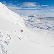 Jón Haukur Steingrímsson skí touring at Botnsúlur mountains.