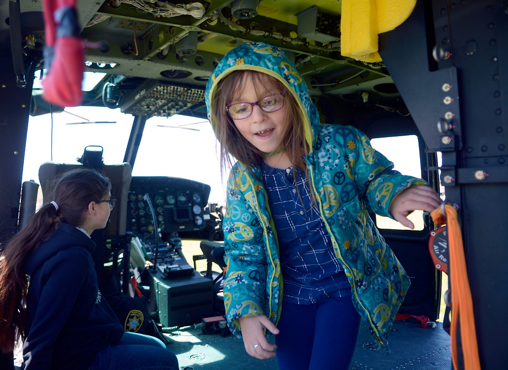 gbs043017j/RIO-WEST -- Jaelynn Archuleta, 7, looks over the cabin of the Metro Air Support UH-1H Huey helicopter during the Day in Paradise celebration in Paradise Park on Sunday, April 30, 2017. The Bernalillo County Sheriff Departments Metro 2 helicopter is mainly used for search and rescue and firefighting according to BCSO Sgt. and pilot Larry Koren. (Greg Sorber/Albuquerque Journal)