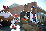 (L to R) D'Varciea Small, Quantaveous Benson, Deandrea Frederick and Edgar Smith sit outside of the Grambling State University Natatorium between classes in Grambling, Louisiana on October 23, 2013.  (Cooper Neill for The New York Times)