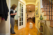 Joy Hahn, Business Development Manager, of Cornerstone Technologies plays with her dog, Zoe, outside her home office at her home in San Jose, California, on March 25, 2013.  (Stan Olszewski/SOSKIphoto)