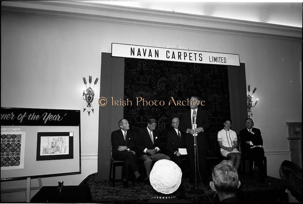 "28/06/1967<br /> 06/28/1967<br /> 28 June 1967<br /> Presentation of prizes at Navan Carpets ""Young Designer of the Year"" reception in the Royal Hibernian Hotel, Dublin. Visible on the stage were (l-r): Mr. B.V. Fox, Navan Carpets Ltd.; Mr. Michael Bourke, Principal of the National College of Art; Mr. James White, Director National Gallery of Ireland; Mr. Allan Mallinson, Managing Director, Navan Carpets Ltd., speaking; Miss Linda Willis, winner of the competition and Mr. J. Short, Navan Carpets Ltd.."