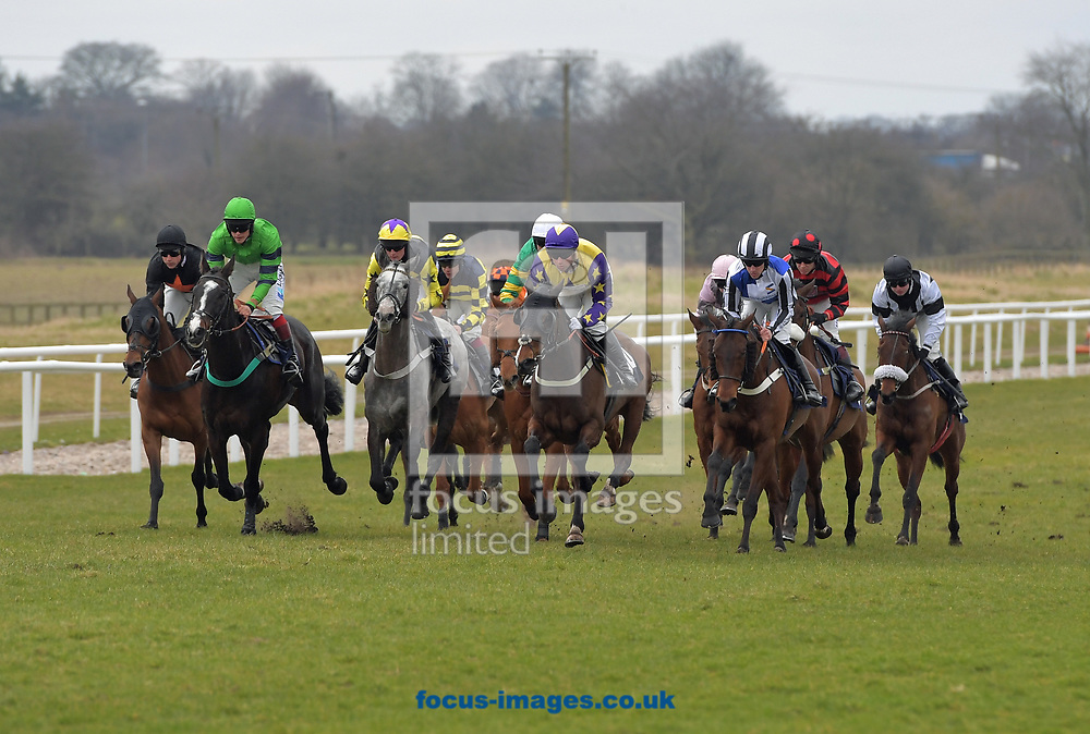 ALLFREDANDNOBELL ridden by Joe Colliver  (yellow stars on sleeves) wins Bulloughs Cleaning Services handicap Hurdle during the Wear A Hat Day meeting  at Wetherby Racecourse, West Yorkshire<br /> Picture by Martin Lynch/Focus Images Ltd 07501333150<br /> 29/03/2018