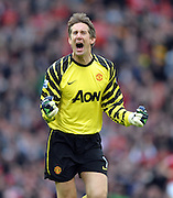 Edwin Van Der Sar celebrates after Nani scores during the Barclays Premier League match between Manchester United and Manchester City at Old Trafford on February 12, 2011 in Manchester, England.