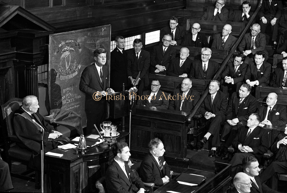 President, Kennedy, speaks, to Dail, in both Houses, 28.06.1963. U.S. President John F. Kennedy, addresses the Irish Parliament in a joint session of the Seanad, and the Dail at Leinster, House, Dublin, Ireland. The President discusses the major role played in American, history by people of Irish descent. Kennedy addresses the Houses of the Oireachtas for 26 minutes.<br />