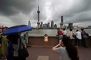 The TV radio tower and new construction in Pudong seen from the Bund on the Shanghai side of the river. Shanghai, China.