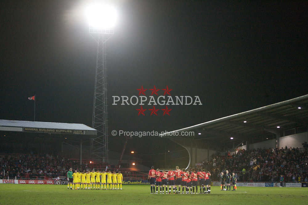 WREXHAM, WALES - Wednesday, February 6, 2008: Wales' and Norway's players stand for a minute's silence to remember the 50th anniversary of the Munich air crash before the international friendly match at the Racecourse Ground. (Photo by David Rawcliffe/Propaganda)