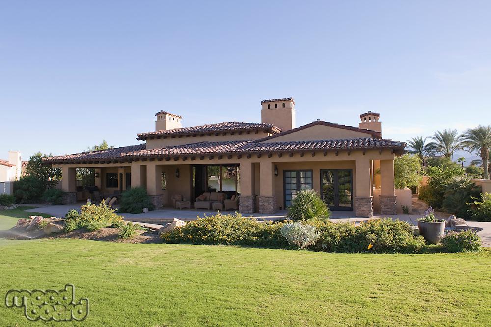 Sunlit garden exterior of Palm Springs home
