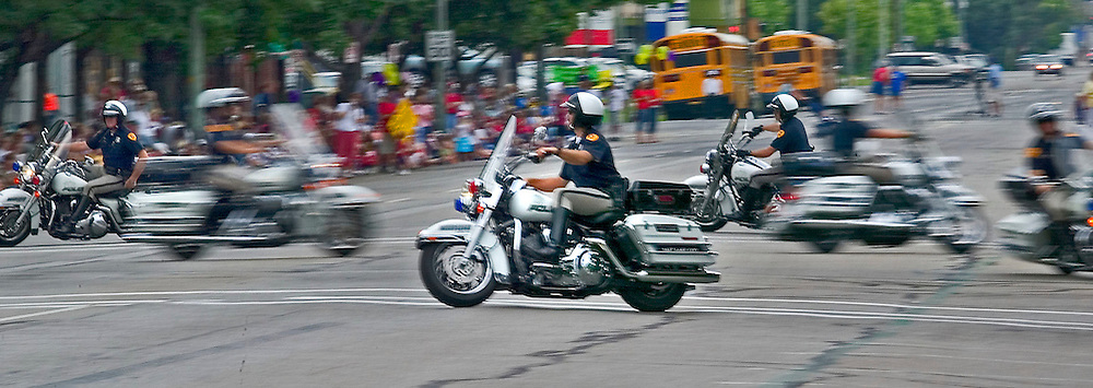 Salt Lake City Police motorycycle riders showcase their riding skills as they participate in the Days of 47 Youth Parade in Salt Lake City, Utah Saturday July 23, 2005.  August Miller/ Deseret Morning News