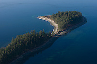 The end of Rebecca Spit provincial marine park on Quadra Island as seen from the air.  Quadra Island, Vancouver Island, British Columbia, Canada.