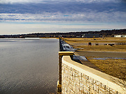 29 MARCH 2019 - ST. PAUL, MN: A temporary flood wall holds back the Mississippi River at the St. Paul Downtown Airport. One runway at the airport is closed because of the potential for flooding and the height of the flood wall. The Mississippi River through the Twin Cities has already hit flood stage. Several roads and parks in St Paul are already closed in anticipation of higher flood levels. Weather forecasters and hydrologists have backed off a little on earlier predictions of severe flooding because the snow melt has been slower than expected.      PHOTO BY JACK KURTZ