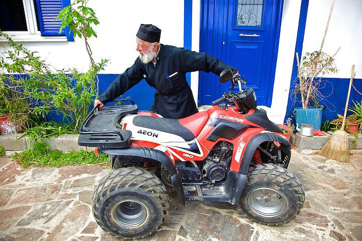 A few years ago, Plakas (100) bought himself an all-terrain vehicle. He uses it when he runs his errands.