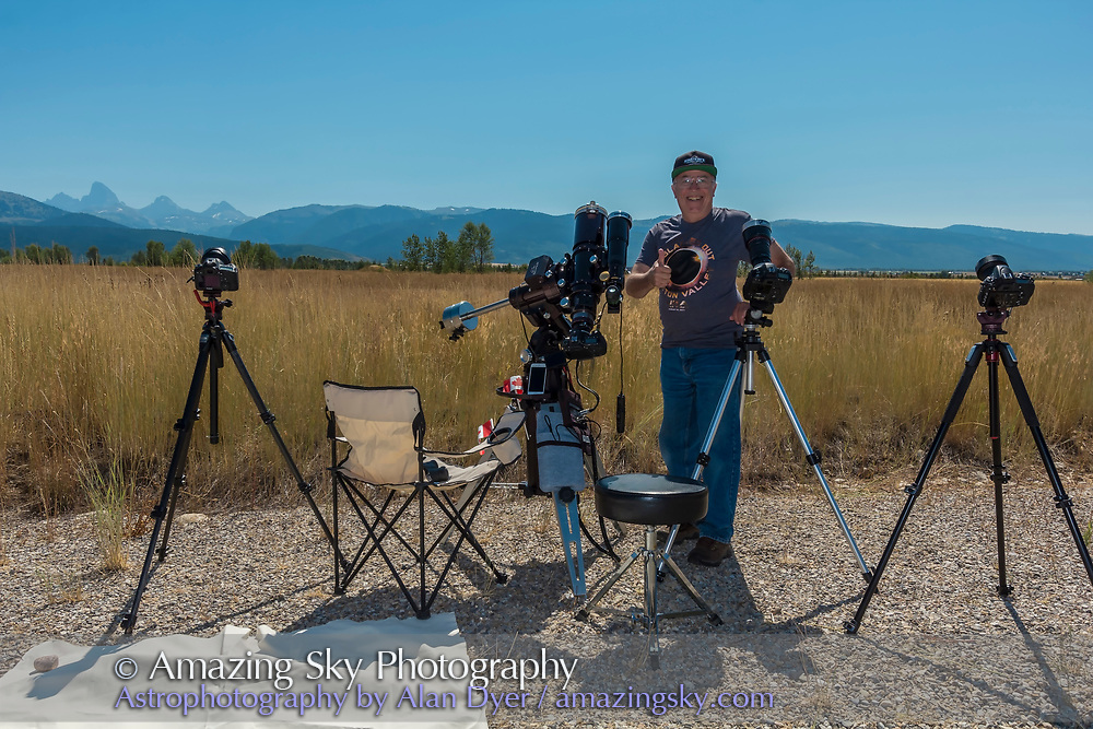 Me at the 2017 total solar eclipse celebrating post eclipse with four of the camera systems I used, for close-up stills through a telescope, for 4K video through a telephoto lens, and two wide-angle time-lapse DSLRs. A fifth camera used to take this image shot an HD video selfie.