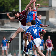 May 2, 2010 - Bronx, NY : New York's Adrian O'Connor (#9) , top center, goes up for a ball against Galway's Joe Bergin (#12), left, as New York's Jason Kelly (#10) watches. . The New York Gaelic Athletic Association  hosted the Galway Tribesmen this past Sunday at Gaelic Field in Riverdale for the opening match of the 2010 Connacht Football Championship. The hosts gave their overseas visitors a ferocious 60 minutes of play before falling 2-13 to 0-12.