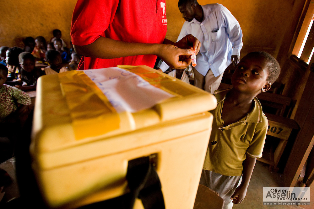 A health worker prepares to vaccinate a child during a national polio immunization exercise at the Moglaa primary school in the town of Moglaa, northern Ghana on Friday March 27, 2009.