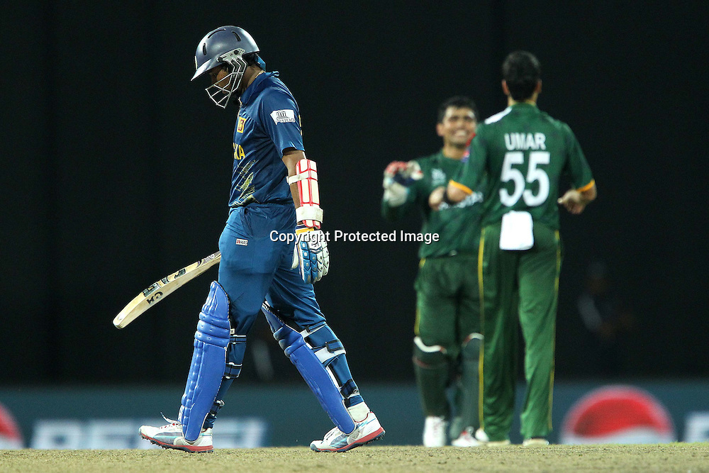 Umar Gul celebrates the wicket of Tilakaratne Dilshan as he departs during the ICC World Twenty20 semi final match between Sri Lanka and Pakistan held at the Premadasa Stadium in Colombo, Sri Lanka on the 4th October 2012<br /> <br /> Photo by Ron Gaunt/SPORTZPICS
