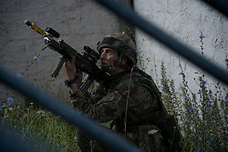 Image shows Officer Cadets from Royal Military Academy Sandhurst (RMAS) participating in Exercise Dynamic Victory on Hohenfels Training Area in Germany.<br /> <br /> 15/07/2016<br /> Credit should read: Cpl Mark Larner RY<br /> <br /> Exercise Dynamic Victory is the last of three accumulative confirmation exercises of the 44 week commissioning course bofore officer cadets are given their commission and proceed to Phase 2 trade training. It tests the cadets suitability to become junior officers in the field army. The skills and drills the Officer Cadets have learned over the previous terms are brought together, forcing the cadets to work in an arduous overseas environment whilst thinking about more than just basic soldiering.
