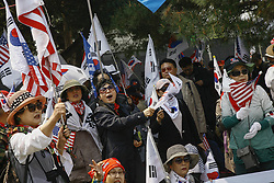 April 27, 2018 - Paju, South Korea - South Korean conservation group members hold U.S and israel flag with shout slogans held on anti-summit protest at imjingak pavilion near unification bridge in Paju, South Korea. South Korean President Moon and North Korean leader Kim has summit in panmunjom today. (Credit Image: © Ryu Seung-Il via ZUMA Wire)