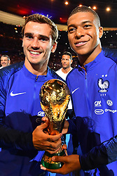 September 9, 2018 - Paris, France - Kylian Mbappe, Atoine Griezmann of France celebrate with the World Cup Trophy after the UEFA Nations League A group official match between France and Netherlands at Stade de France on September 9, 2018 in Paris, France. This is the first match of the French football team at the Stade de France since their victory in the final of the World Cup in Russia. (Credit Image: © Mehdi Taamallah/NurPhoto/ZUMA Press)