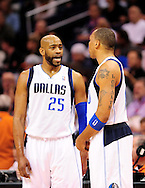Mar. 08, 2012; Phoenix, AZ, USA;  Dallas Mavericks guard Vince Carter (25) talks with teammate forward Shawn Marion (0) while playing against the Phoenix Suns during the first half at the US Airways Center.  Mandatory Credit: Jennifer Stewart-US PRESSWIRE.