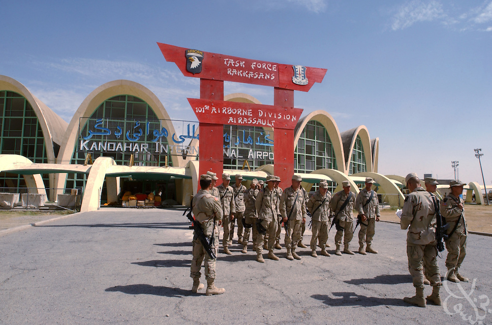 U.S. Army soldiers from the 101st Airborne Division Rakkasan task force stand in formation May 12, 2002 at their Kandahar Airfield forward operating base in southern Afghanistan. The 101st Airborne Division saw troops deployed in Afghanistan as part of Operation Enduring Freedom.