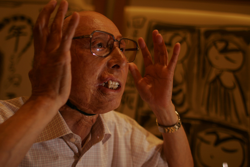 """Mr.Yoshida was a second year student in the shipbuilding course at Nagasaki Prefecture School of Industrial Science. He received three major skin transplant operations at the Omura Naval Hospital after the bombing and has undergone numerous transplants since then.??August 9,1945. No matter how hard I try, I have never been able to forget the events of that morning.?An air-raid alarm was sounded but soon lifted. Seven students including myself left the shelter and began to walk back toward school. Along the way we stopped at a roadside house to draw drinking water from the well. For no particular reason, I looked up at the sky to my right when about to drop the bucket into the water, and I noticed two parachutes falling between a crack in the clouds. My friends also looked up, shading their eyes with their hands.??Suddenly, there was a violent explosion and I was thrown across the road into a rice paddy. Other survivors have described the experience of the atomic bombing by the expression pika-don [an onomatopoeic term equivalent to """"flash-boom""""], but for me it all happened in a fleeting dream-like instant.??It is said that there is no pain when injuries exceed a certain degree of severity. I was aware during the brief space of time between the explosion and my impact against the ground. It seemed like a fish was being fried and I could feel my body curl up with the intense heat. People usually associate blisters with burns, but when I regained consciousness in the rice paddy I found myself covered in blood. The skin on my arms had peeled off and was hanging down like a torn shirt from my fingertips. The open flesh was bright red with blood, but strangely enough there was no pain. On the contrary, I felt as healthy and energetic as ever. Along with my friends, I told myself that it was only a minor burn and that a little ammonia tincture would cure everything. The relief at having survived perhaps blocked out other perceptions temporarily.??However, I was shocked to"""