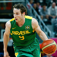 06 August 2012: Brazil Marcelinho Huertas brings the ball upcourt during 88-82 Team Brazil victory over Team Spain, during the men's basketball preliminary, at the Basketball Arena, in London, Great Britain.
