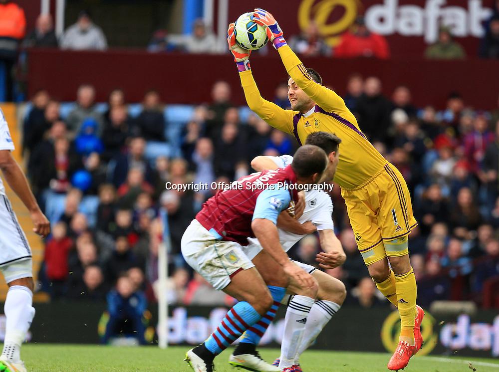 21st March 2015 - Barclays Premier League - Aston Villa v Swansea City - Swansea keeper Lukasz Fabianski saves from Gabriel Agbonlahor of Aston Villa - Photo: Paul Roberts / Offside.
