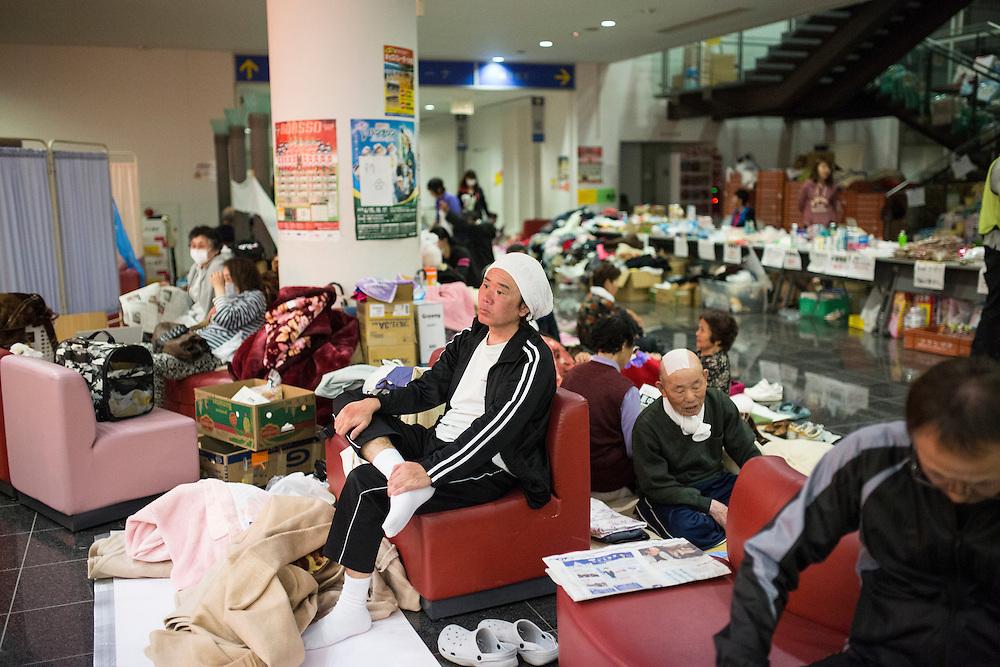 KUMAMOTO, JAPAN - APRIL 19: A man sitting inside the Mashiki Town Gymnasium evacuation center on April 19, 2016 in Mashiki, Kumamoto, Japan. This is their fourth day in the evacuation center since magnitude-6.3 quake hit Kumamoto city.<br /> <br /> Photo: Richard Atrero de Guzman