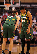 Sep 5, 2010; Phoenix, AZ, USA; Seattle Storm guard Sue Bird (10) talks with teammate guard Tanisha Wright (30) on the court during the second half in game two of the western conference finals in the 2010 WNBA Playoffs at US Airways Center.  The Storm defeated the Mercury 91-88.  Mandatory Credit: Jennifer Stewart-US PRESSWIRE