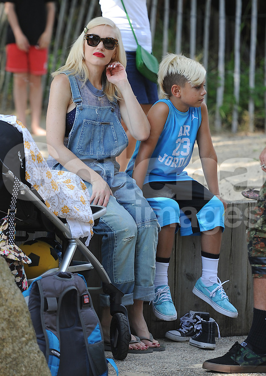 Singer Gwen Stefani, Gavin Rossdale and their three boys Kingston Rossdale, Zuma Nesta Rock Rossdale, Apollo Bowie Flynn Rossdale  enjoy a day out at a London park, UK. 22/07/2014<br />BYLINE MUST READ : GOTCHAIMAGES.COM<br /><br />Copyright by &copy; Gotcha Images Ltd. All rights reserved.<br />Usage of this image is conditional upon the acceptance <br />of Gotcha Images Ltd, terms and conditions available at<br />www.gotchaimages.com