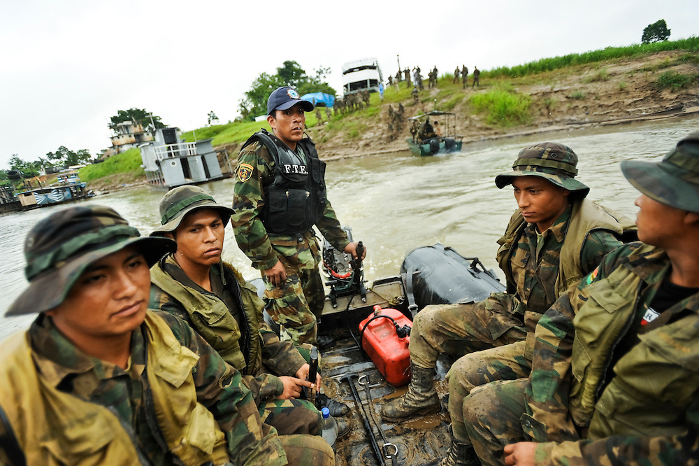 Counternarcotics forces cross a river during a patrol to eradicate coca patches that are over the legal limit in Chapare. It's estimated that 90 percent of coca from the Chapare goes to the drug trade.