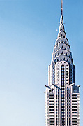 The Chrysler Building against a light blue sky
