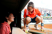 Roland Garros. Paris, France. June 1st 2012.A day with the ball boys..A coach give an instruction to a kid of her team.