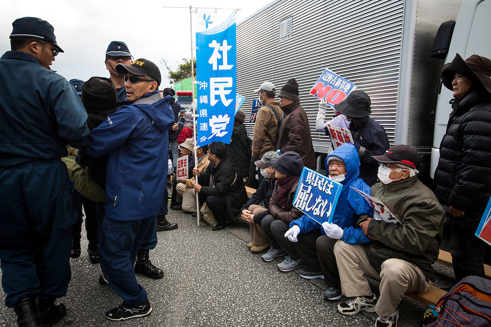 OKINAWA, JAPAN - JANUARY 21 : Police remove anti-U.S. Base protesters during a rally outside of the gate of Camp Schwab to protest against the construction of the new U.S Marine Airbase in Henoko, Nago, Okinawa, Japan on June 21, 2017. (Photo by Richard Atrero de Guzman/ANADOLU Agency)