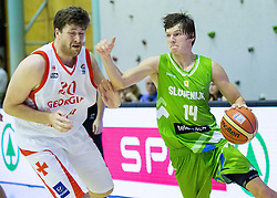 George Sharabidze of Georgia vs Jaka Klobucar of Slovenia during friendly basketball match between National teams of Slovenia and Georgia in day 2 of Adecco Cup 2014, on July 25, 2014 in Dvorana OS 1, Murska Sobota, Slovenia. Photo by Vid Ponikvar / Sportida.com