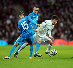 Adam Lallana of England (Liverpool) battles for the ball with Andraz Struna of Slovenia   - Photo mandatory by-line: Joe Meredith/JMP - Mobile: 07966 386802 - 15/11/2014 - SPORT - Football - London - Wembley - England v Slovenia - EURO 2016 Qualifier