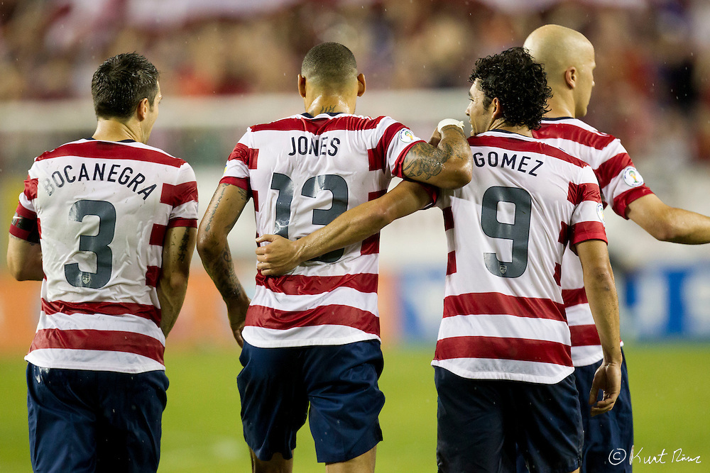 USA Men's National Team forward HERCULEZ GOMEZ (9),  midfielder JERMAINE JONES (13), and defender CARLOS BOCANEGRA (3) celebrate after a goal during the Antigua & Barbuda vs USA Men's National Team  semifinal round of 2014 FIFA World Cup qualifier at Raymond James Stadium in Tampa, Fl. .