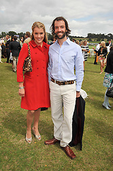 NED ABEL SMITH and the HON.ELIZA PEARSON at the 2009 Veuve Clicquot Gold Cup Polo final at Cowdray Park Polo Club, Midhurst, West Sussex on 19th July 2009.