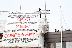 © Licensed to London News Pictures. 28/01/2013. London, UK. A man (L) talks to a police negotiator (R) as he protests against an alleged miscarriage of justice on the roof of a building in Fleet Street, London, today (28/01/13). Photo credit: Matt Cetti-Roberts/LNP