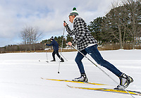 Calvin Roberts on classic and Ben Hillsgrove on skate skis head out on the trails at Bolduc Park Friday afternoon after our first substantial snowfall of the season.  (Karen Bobotas/for the Laconia Daily Sun)