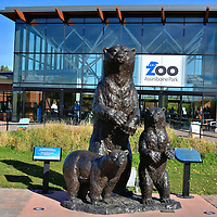 Assiniboine Park Zoo Entrance in Winnipeg, Canada<br /> The Assiniboine Park Zoo is one of the top attractions in Winnipeg.  Since it opened in 1904, it has grown into 400 acres with exhibits of 1,500 animals representing 150 species. At the entrance plaza is this bronze ensemble called Mother Polar Bear and Cubs.  It is the work of sculptor Peter Sawatzky.  It was donated in late 2014 by Bob Williams who was the former chairman of Polar Bears International. Mama bear stands about nine feet.
