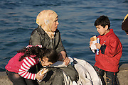 Istanbul. Mother and kids having a snack at the Bosporus.