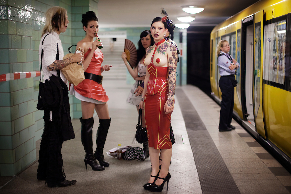 U Bahn Alexanderplatz, Berlin, 2009...PORTFOLIO...Liz and her friends are waiting before a fashion show at the subway station Berlin Alexanderplatz in Berlin. She is a model for Rockstar Models, a Berlin agency only for models with tattoos and piercings. ..Photo: Andrea Gjestvang/MOMENT