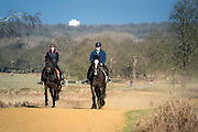 © Licensed to London News Pictures. 22/03/2015. Richmond, UK. Horse riders enjoy the warm temperature.  People enjoy the late afternoon sunshine in Richmond Park, Surrey, today 22nd March 2015. Photo credit : Stephen Simpson/LNP